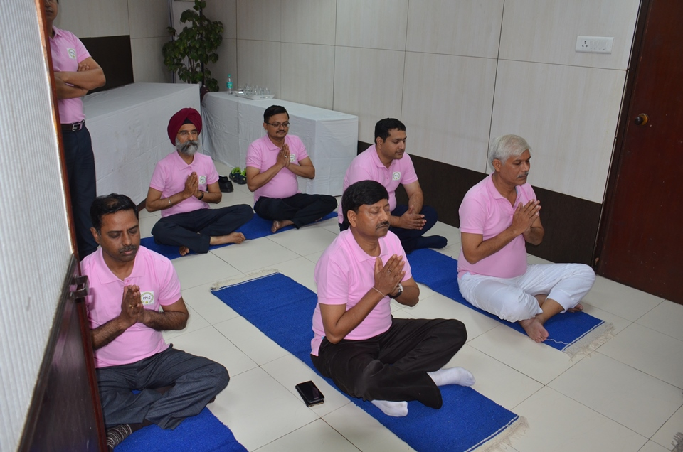Employees of PPAC listening to Yoga Geet on International Yoga Day Photo Gallery
