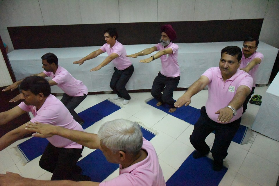 Employees of PPAC performing Yoga in office on International Yoga Day Photo Gallery